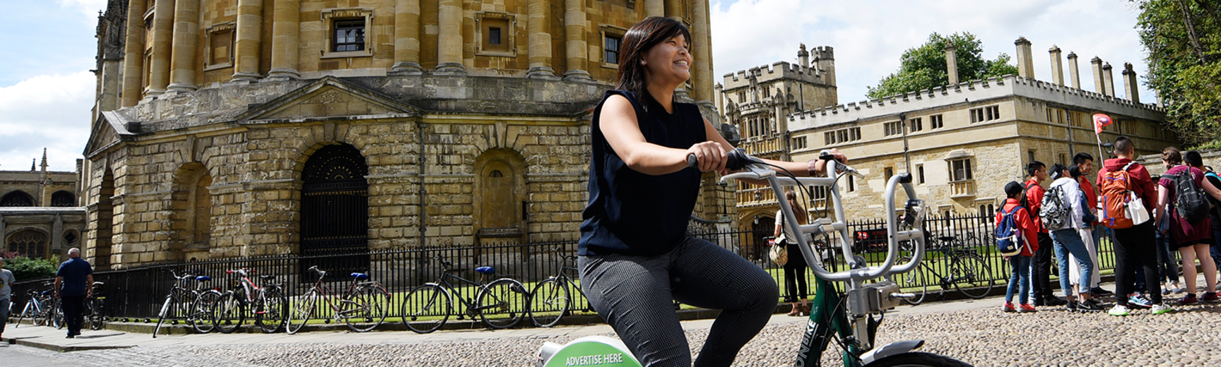 Image of cyclist riding around the Radcliffe camera